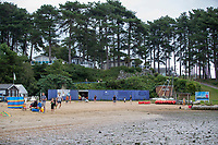BNPS.co.uk (01202) 558833. <br /> Pic: BNPS<br /> <br /> Pictured: The beach at at Rockley Point in Poole Harbour, Dorset. <br /> <br /> There are fresh calls for a holiday park to increase safety measures at a notorious beach where one swimmer has drowned and almost 20 children rescued this summer. <br /> <br /> In the latest incident a dad and his two young sons were plucked to safety in the nick of time after they were swept away by a rip tide at Rockley Park in Poole Harbour, Dorset.<br /> <br /> It happened a month after hero swimmer Callum Baker-Osborne, 18, drowned while helping to rescue 13 children at the same spot.<br /> <br /> And before that two young girls were saved from drowning by a paddleboarder.