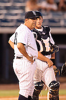 Tampa Yankees manager Luis Sojo #19 and catcher Mitch Abeita #29 look to the bullpen during a game against the Clearwater Threshers at Steinbrenner Field on June 22, 2011 in Tampa, Florida.  The game was suspended due to rain in the 10th inning with a score of 2-2.  (Mike Janes/Four Seam Images)