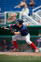 Lowell Spinners third baseman Korby Batesole (12) lays down a bunt base hit during a game against the Batavia Muckdogs on July 15, 2018 at Dwyer Stadium in Batavia, New York.  Lowell defeated Batavia 6-2.  (Mike Janes/Four Seam Images)