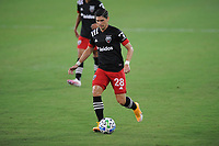 WASHINGTON, DC - AUGUST 25: Joseph Mora #28 of D.C. United moves the ball during a game between New England Revolution and D.C. United at Audi Field on August 25, 2020 in Washington, DC.