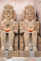 Italy. Province of Veneto. Castelnuovo del Garda. As a preparation for Halloween, two large pumpkins are on the knees of the egyptian gods at the attration's entrance: La Valle dei Re Gardaland is the biggest amusement park in Italy and one of the largest in the whole of Europe.  © 2006 Didier Ruef