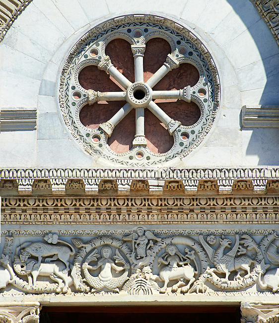 Detail of the Romanesque sculptures and Rose Window of the main entrance of San Michele in Foro is a Roman Catholic basilica church in Lucca, Tunscany, Italy