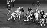 Bethel Park PA:  Offensive play with Bethel running the Houston veer triple option. Clark Miller 30 running the ball off right guard after good blocks by Dennis Franks 66, Joe Barrett 75 and Don Troup 51, and Bob Hensler 77. Others in the photo; Mike Stewart 11, Gary Biro 81. The offense and defense did not play well in the 12-6 defeat vs Montour. Montour's quarterback, Bill Daniels, killed the Blackhawks.  Bill Daniels was played his college ball at Pitt.  The defensive unit was one of the best in Bethel Park history only allowing a little over 7 points a game.