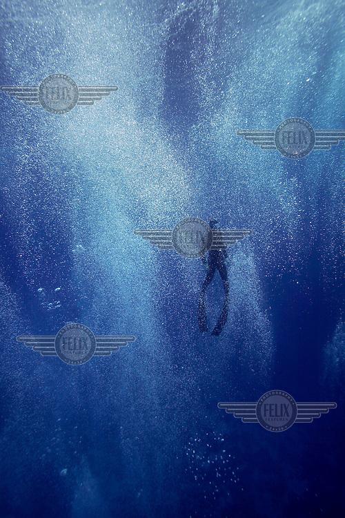 Freediver in bubbles made by scuba divers. Freediving in Dahab,Sinai in Egypt. © Fredrik Naumann/Felix Features