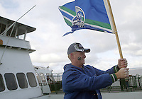 27 Nov 2005:   Seattle Seahawks super fan John Perkins from Bremerton Washington held up a 12th man flag on the front of the Bremerton too Seattle 10:15 ferry on his way to watching the Seattle Seahawks Vs New York Giants game at Qwest Field in Seattle, Washington.