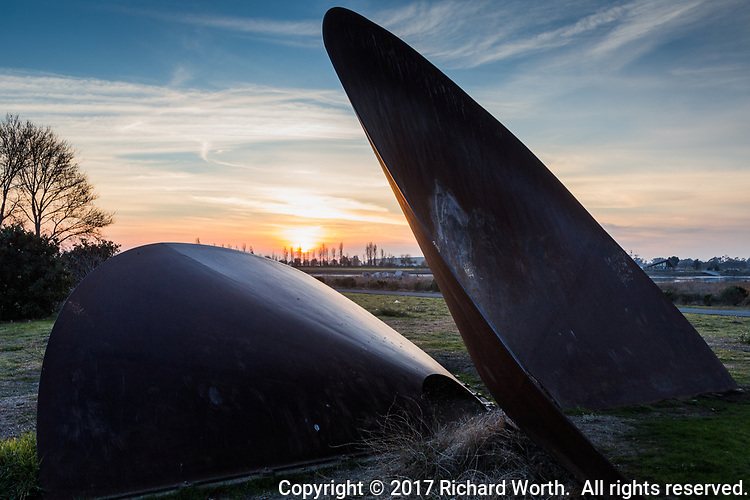 """The """"Duplex Cones"""" at sunset, a work of urban art at the Martin Luther King Jr. Regional Shoreline across from the Oakland International Airport on San Francisco Bay"""