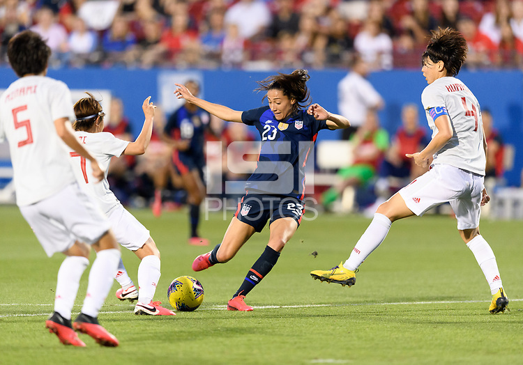FRISCO, TX - MARCH 11: Christen Press #23 of the United States battles for the ball in the first half against Japan during a game between Japan and USWNT at Toyota Stadium on March 11, 2020 in Frisco, Texas.