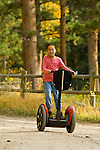 Folks of all ages enjoy the freedom and control of riding Segways through fall colors in Estes Park , Colorado, high in the Rocky Mountains. Segways provided by Segway of Northern Colorado. Model releases #96, 126