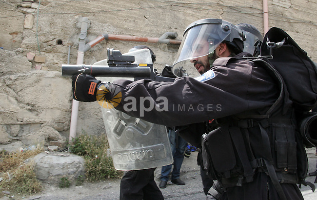 Israeli border policeman takes aim with a teargas grenade launcher in the East Jerusalem neighborhood of A-Tur, on 13 May 2011. Riots broke out in several flashpoints in East Jerusalem following the Friday Prayers. following Friday prayers on 13 May 2011. Israel bolstered its security in Jerusalem ahead of the Palestinians marking 'Nakba Day,' the Palestinian term for the 'catastrophe' when Palestinians were uprooted from their homes and land and made refugees, with the establishment of the State of Israel. Photo by Mahfouz Abu Turk