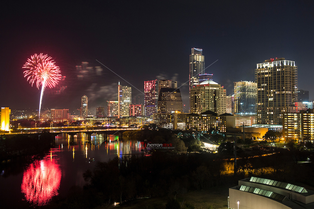 Aerial view as Austin welcomes the New Year as fireworks explode over the downtown Austin skyline and Lady Bird Town Lake.