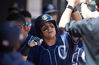 Mickey Gasper (8) of the Charleston RiverDogs is congratulated by his teammates after hitting a solo home run against the Hickory Crawdads at L.P. Frans Stadium on May 13, 2019 in Hickory, North Carolina. The Crawdads defeated the RiverDogs 7-5. (Brian Westerholt/Four Seam Images)