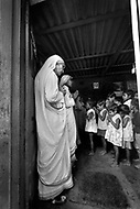 """Calcutta, India. April 04, 1975. Mother Teresa praying with children in the morning at her orphange. Mother Teresa (Agnes Gonxha Boyaxihu) the Roman Catholic, Albanian nun revered as India's """"Saint of the Slums,"""" was awarded the 1979 Nobel Peace Prize. Mother Teresa (Agnes Gonxha Boyaxihu) the Roman Catholic, Albanian nun revered as India's """"Saint of the Slums,"""" was awarded the 1979 Nobel Peace Prize."""
