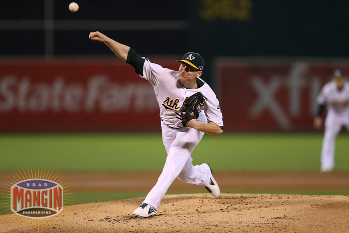 OAKLAND, CA - OCTOBER 11:  Jarrod Parker of the Oakland Athletics pitches during Game 5 of the ALDS against the Detroit Tigers at O.co Coliseum on October 11, 2012 in Oakland, California. (Photo by Brad Mangin)