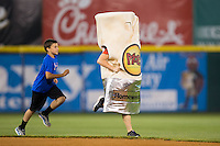 A young fan races after the Moe's Burrito between innings of the South Atlantic League game between the Rome Braves and the Hickory Crawdads at L.P. Frans Stadium on May 12, 2016 in Hickory, North Carolina.  The Braves defeated the Crawdads 3-0.  (Brian Westerholt/Four Seam Images)