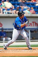 Biloxi Shuckers outfielder Tyrone Taylor (15) squares to bunt during the first game of a double header against the Pensacola Blue Wahoos on April 26, 2015 at Pensacola Bayfront Stadium in Pensacola, Florida.  Biloxi defeated Pensacola 2-1.  (Mike Janes/Four Seam Images)