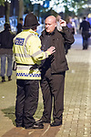© Joel Goodman - 07973 332324  . 03/10/2011 . Manchester, UK . A policeman speaks to a security guard during a protest against a Gay Conservative fringe event in Manchester Gay Village during the 2011 Conservative Party Conference at the Manchester Central Convention Centre (formerly GMex) . Photo credit: Joel Goodman