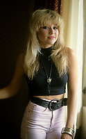 """Montreal (Qc) CANADA - File Photo - Circa 1986- EXCLUSIVE PHOTO -<br /> Elizabeth (E.G.) Daily pose during an interview in her Montreal hotel room.<br /> <br /> She was a popular singer in the eighties ;<br /> her single """"Say It, Say It"""". claimed the #1 spot on the Hot Dance Music/Club Play chart.<br /> <br /> Her songs were often featured in movies and videogames. She has few movie roles including playing Hilton's mother in National Lampoon's Pledge This!.<br /> <br /> Daily was married to Rick Salomon from 1995 ó 2000. They have two daughters, Hunter (b. 1996) and Tyson (b. 1998). She dated among others; Jon-Erik Hexum, George Clooney, Nicolas Cage, Kato Kaelin, and Andrew """"Dice"""" Clay<br /> <br /> <br /> -Photo (c)  Images Distribution"""