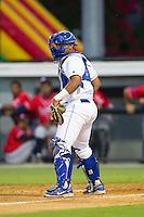Burlington Royals catcher Xavier Fernandez (4) on defense against the Danville Braves at Burlington Athletic Park on July 5, 2014 in Burlington, North Carolina.  The Royals defeated the Braves 5-4.  (Brian Westerholt/Four Seam Images)
