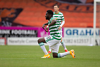 22nd August 2020; Tannadice Park, Dundee, Scotland; Scottish Premiership Football, Dundee United versus Celtic; Odsonne Edouard of Celtic takes a knee pre match
