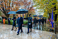 President Donald J. Trump (front right), First Lady Melania Trump (front left), Vice President Mike Pence (back right), and Second Lady Karen Pence (back left) walk through the State and Territorial Flag cordon to the Tomb of the Unknown Soldier at Arlington National Cemetery, Arlington, Virginia, November 11, 2020. President Trump and Vice President Pence came to ANC to participate in a Presidential Armed Forces Full Honor Wreath-Laying Ceremony at the Tomb of the Unknown Soldier as part of the nation's 67th Veterans Day Observance. (U.S. Army photo by Elizabeth Fraser / Arlington National Cemetery / released)