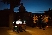 A musical performs on the street near the Roman Forum on Tuesday, Sept. 22, 2015, in Rome, Italy. (Photo by James Brosher)