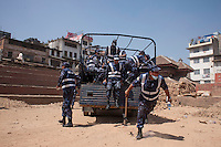 Nepali police force jumps from a truck as they arrived at Kathmandu Durbar Square for rescue operation, Kathmandu, Nepal. May 03, 2015