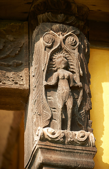 Medieval wood carving of Eve on the gate house of the  finest fortified medieval manor house in England built in the 1280s, Stokesay Castle, Shropshire, England