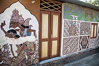 Yogyakarta, Java, Indonesia.  Wall Murals on House near Taman sari (Water Castle).