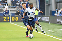 KANSAS CITY, KS - MAY 16: Cristian Dajome #11 Vancouver Whitecaps held by Ilie Sanchez #6 Sporting KC during a game between Vancouver Whitecaps and Sporting Kansas City at Children's Mercy Park on May 16, 2021 in Kansas City, Kansas.