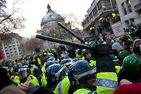 Police baton charge protestors on Parliament Square during a student demonstration in Westminster, central London on the day the government passed a bill to increase university tuition fees.