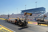 Mar. 13, 2011; Gainesville, FL, USA; NHRA top fuel dragster driver Del Worsham (left) races Antron Brown during the Gatornationals at Gainesville Raceway. Mandatory Credit: Mark J. Rebilas-