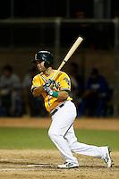 Gabriel Santana #6 of the AZL Athletics bats against the AZL Dodgers at Phoenix Municipal Stadium on July 10, 2013 in Phoenix, Arizona. AZL Athletics defeated the AZL Dodgers, 7-1. (Larry Goren/Four Seam Images)