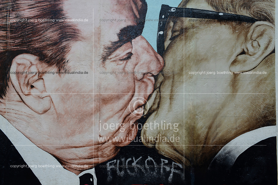 Germany, Berlin, The wall, East side gallery, wall paintíngs and murals about the cold war and walls, painting the kiss of soviet leader Breshnev and east german leader Erich Honecker by Dimitry Vrubel, after a photograph of Régis Bossu taken in Oct. 1979