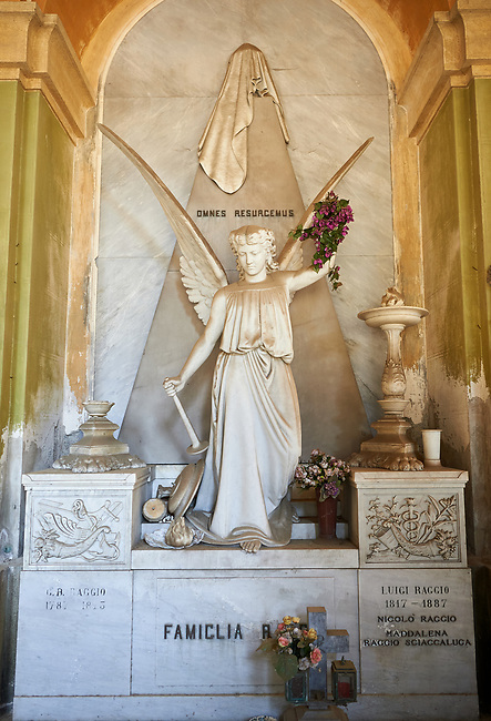 Picture and image of the stone sculpture of an angel on the Raggio Family Tomb 1887. The monumental tombs of the Staglieno Monumental Cemetery, Genoa, Italy