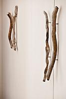 Detail of rustic wooden cupboard door handles