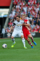 Sun 06 October 2013 Pictured: Angel Rangel in a tussle with James Ward-Prowse of Southampton  Re: Barclays Premier League Southampton FC  v Swansea City FC  at St.Mary's Stadium, Southampton