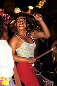Brazil. Girl drummer with braided hair.