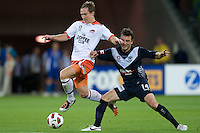 MELBOURNE, AUSTRALIA - DECEMBER 03: Matt McKay of the Roar and Billy Celeski from the Victory compete for the ball during the round 17 A-League match between the Melbourne Victory and the Brisbane Roar at AAMI Park on December 3, 2010 in Melbourne, Australia. (Photo by Sydney Low / Asterisk Images)
