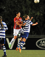 20130906 - OOSTAKKER , BELGIUM : Gent's Margaux Van Ackere pictured withPSV Manon Van Den Boogaard (left) during the female soccer match between AA Gent Ladies  and PSV / FC Eindhoven Dames , of the third matchday in the BENELEAGUE competition. Friday 06 th September 2013. PHOTO DAVID CATRY