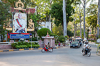 Cambodia, Siem Reap.  Street Traffic, with Poster in Honor of Former King Norodom Sihanouk.