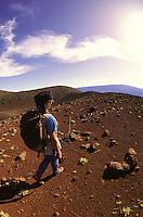Hiker on slopes of Mauna Kea volcano. Hawaii