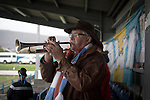 Port Talbot Town 3 Caerau Ely 0, 06/02/2016. Genquip Stadium, Welsh Cup fourth round. A home supporters blows his own trumpet as Port Talbot Town play host to Caerau Ely in a Welsh Cup fourth round tie at the Genquip Stadium, formerly known as Victoria Road. Formed by exiled Scots in 1901 as Port Talbot Athletic, they competed in local and regional football before being promoted to the League of Wales  in 2000 and changing their name to the current version a year later. Town won this tie 3-0 against their opponents from the Welsh League, one level below the welsh Premier League where Port Talbot competed, watched by a crowd of 113. Photo by Colin McPherson.