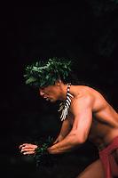 Hawaiian man chanting while dancing hula