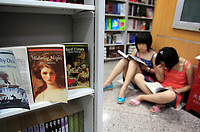 CHINA. Inside Wangfujing bookstore in central Beijing where many English books are on sale, including many British classics. The rise in use of English in China is evident on the streets of Beijing where store-fronts, billboards and clothes all sport English words and phrases. 2009