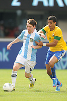 Argentina forward Lionel Messi (10) goes against Brazil midfielder Romulo (8) The Argentina National Team defeated Brazil 4-3 at MetLife Stadium, Saturday July 9 , 2012.