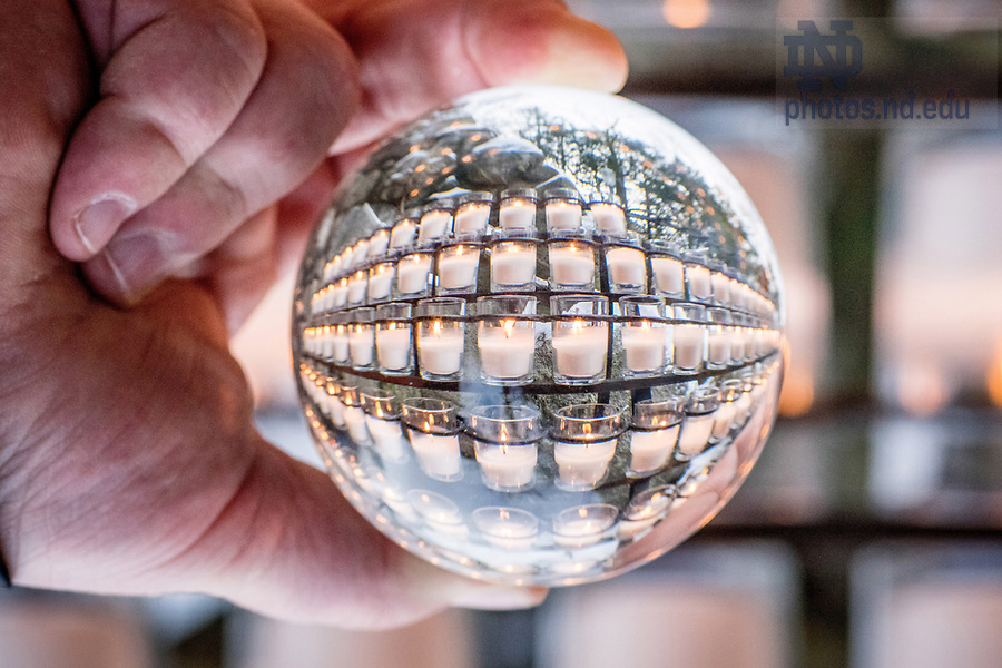 December 14, 2017; Grotto candles refracted in a crystal ball. 11 of 12 (Photo by Matt Cashore/University of Notre Dame)
