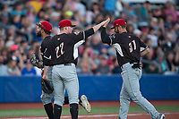 Salem-Keizer Volcanoes starting pitcher Jake Wong (22) congratulates right fielder Dalton Combs (31) after robbing a home run during a Northwest League game against the Hillsboro Hops at Ron Tonkin Field on September 1, 2018 in Hillsboro, Oregon. The Salem-Keizer Volcanoes defeated the Hillsboro Hops by a score of 3-1. (Zachary Lucy/Four Seam Images)