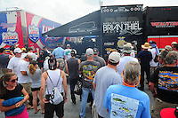 May 13, 2011; Commerce, GA, USA: Fans surround the pit area of NHRA funny car driver Brian Thiel as he warms up his car during qualifying for the Southern Nationals at Atlanta Dragway. Mandatory Credit: Mark J. Rebilas-