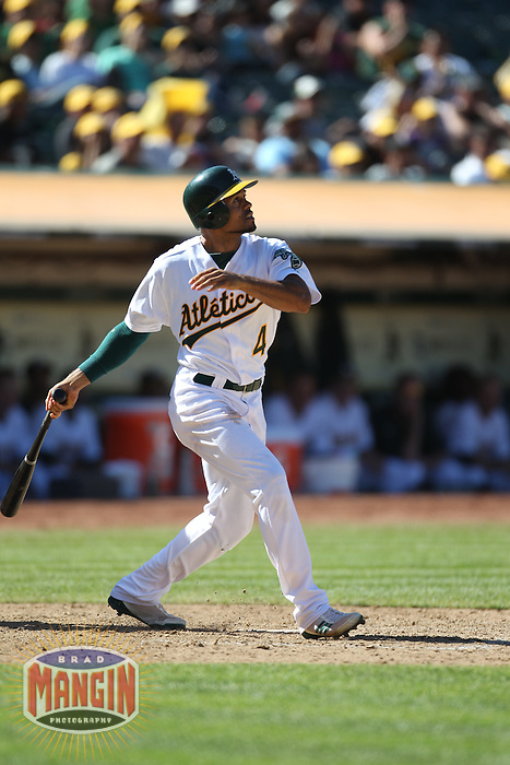 OAKLAND, CA - AUGUST 14:  Coco Crisp #4 of the Oakland Athletics bats against the Texas Rangers during the game at O.co Coliseum on August 14, 2011 in Oakland, California. Photo by Brad Mangin