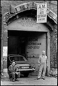 A.M. & Son, car repair workshop, King's Cross, one of many small businesses renting space under disused railway arches in Midland Road, 1990.